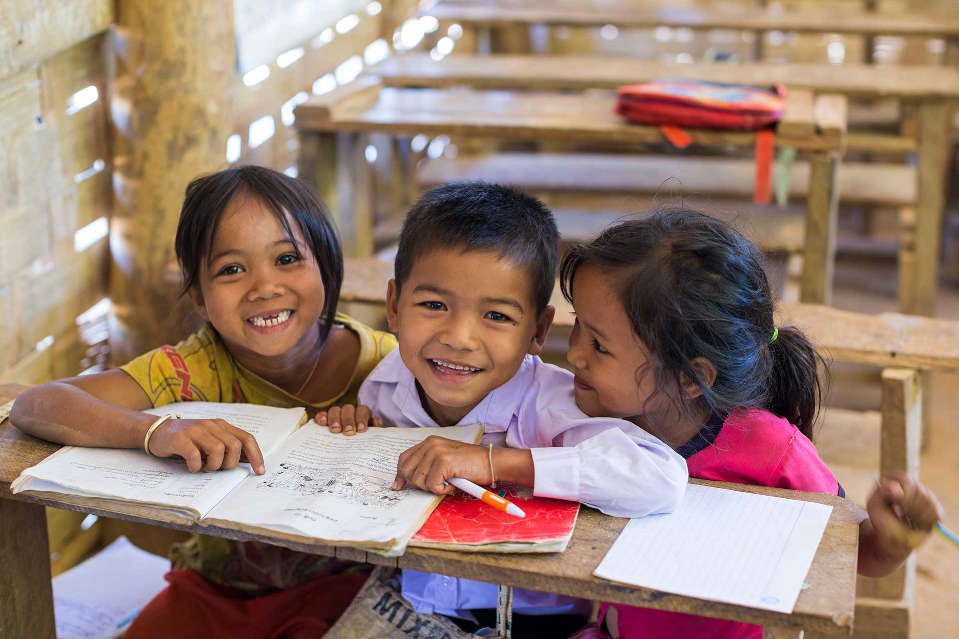 Three Lao school kids smiling